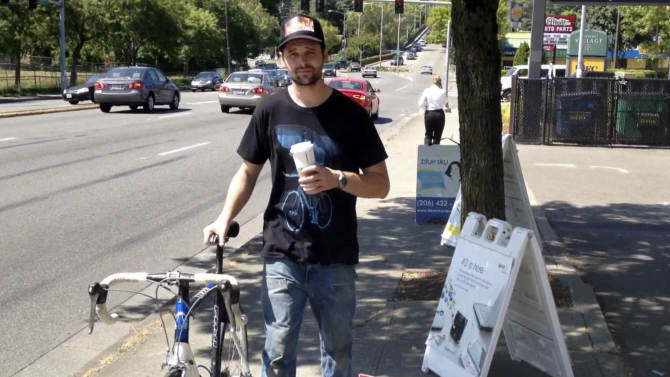 This image taken from YouTube shows Jake Gillum, of Portland, Ore. after he recovered his stolen bike, in Seattle. After the bike was stolen in Portland while Gillum was on a date, he tracked it down via Craigslist, confronted the accused thief, recorded the sting operation and then posted it to YouTube. (AP Photo/YouTube)