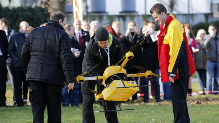 "A prototype ""parcelcopter"" of DHL is prepared for take off outside the DHL headquarters in Bonn"