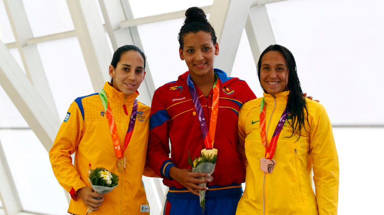 Pinto, Composano, and Bruin pose for the media during the awards ceremony of the women's swimming freestyle 200m event at the South American Games (ODESUR) in Santiago