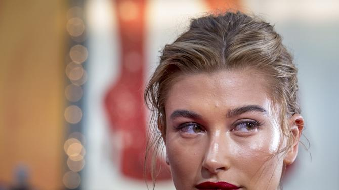 "Model Hailey Baldwin poses on the red carpet for a screening of the film ""Mission Impossible: Rogue Nation"" in New York"