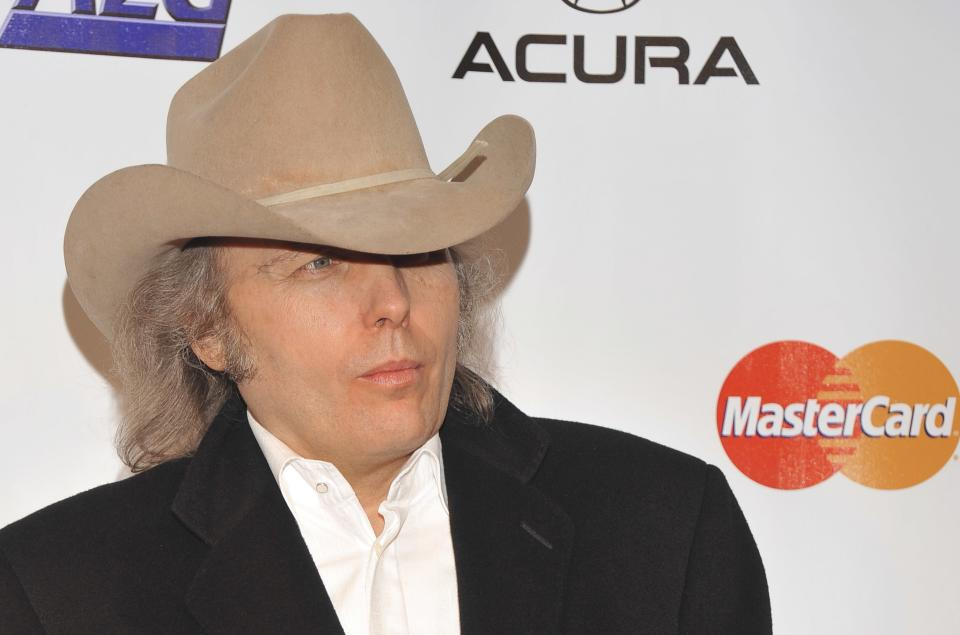 FILE - This Jan. 29, 2010 file photo shows country singer Dwight Yoakam arriving at the MusiCares Person of the Year tribute honoring Neil Young in Los Angeles.  Yoakam's first album in his return to Warner Bros. Records comes out Sept. 18, 2012. (AP Photos/Vince Bucci, file)