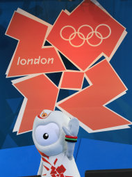 Olympic mascot Wenlock waves as its appears on stage during the London 2012 Olympic one year to go ceremony at Trafalgar Square in London, Wednesday, July 27, 2011. (AP Photo/Sang Tan)
