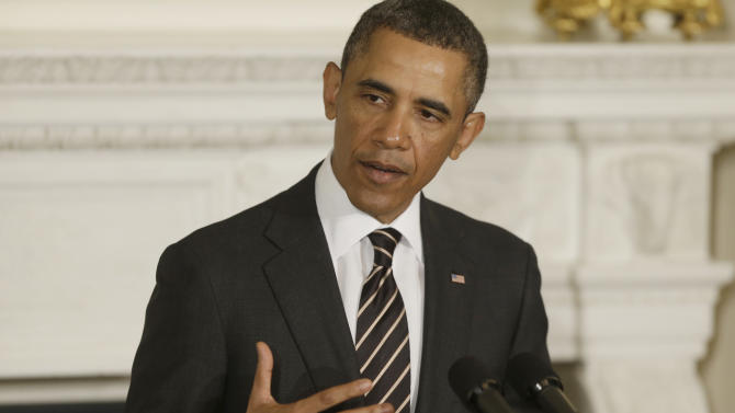 Obama warns spending cuts could idle shipbuilder