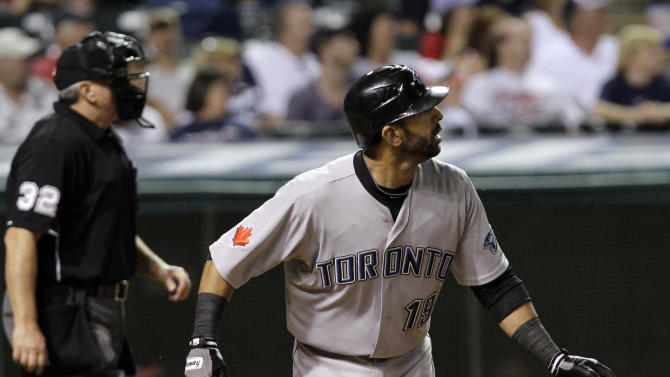 Toronto Blue Jays' Jose Bautista watches the flight of his solo home run off Cleveland Indians relief pitcher Tony Sipp while home plate umpire Dana DeMuth looks on during the ninth inning of a baseball game, Thursday, July 7, 2011, in Cleveland. (AP Photo/Amy Sancetta)