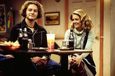 "Guest star Melissa Joan Hart (R) flashes back to the '70s when her character gets set up on a date with Hyde (Danny Masterson, L) on the ""Eric Gets Suspended"" episode of Fox's That 70s Show"