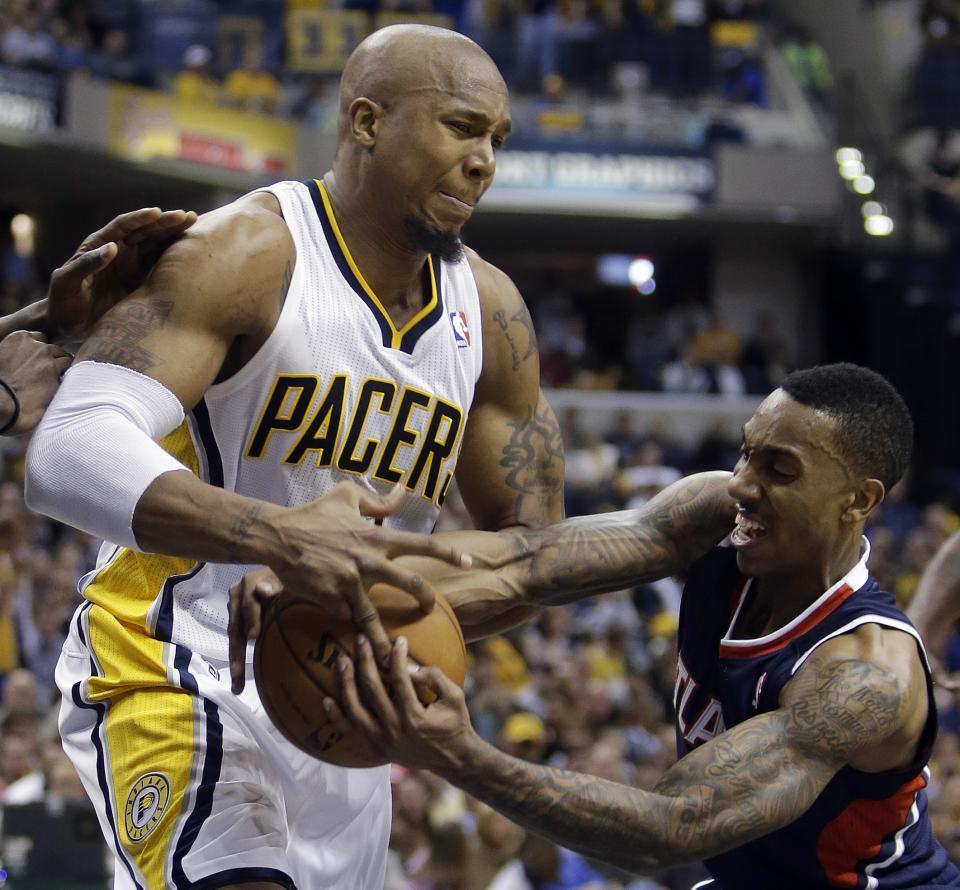 Indiana Pacers' David West, left, and Atlanta Hawks' Jeff Teague battle for a loose ball during the second half of Game 1 in the first round of the NBA basketball playoffs, Sunday, April 21, 2013, in Indianapolis. Indiana won 107-90. (AP Photo/Darron Cummings)