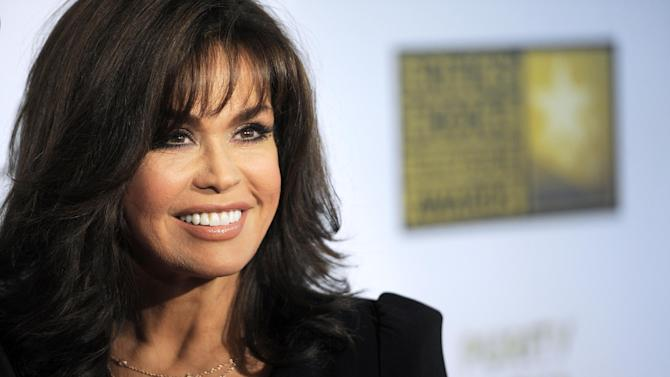 """FILE - This June 10, 2013 file photo shows TV host Marie Osmond at the Critics' Choice Television Awards in Beverly Hills, Calif. Hallmark Channel announced that they are canceling Osmonds' show """"Marie."""" (Photo by Chris Pizzello/Invision/AP, File)"""
