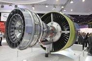 <p>Visitors look at the LEAP engine by SAFRAN Snecma selected by Airbus to power the A320neo and by COMAC for the C919, at the International Paris Air Show on June 22, 2011. The C919 plane is a symbol of national pride which would compete with Boeing's 737 and the A320 of European consortium Airbus, but catching up might take at least a decade, industry officials and analysts said.</p>