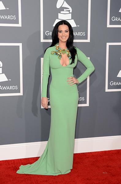 WORST: Katy Perry wearing Gucci On the runway, the window in Katy Perry's dress was a tasteful slit. Tonight at the Grammy's, it was a gratuitous flesh display. And the color washed her out. Dislike.