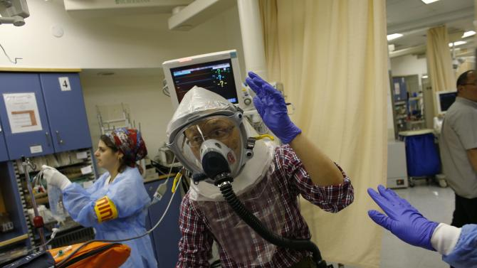 A member of a delegation from China takes part in a chemical warfare drill in Jerusalem