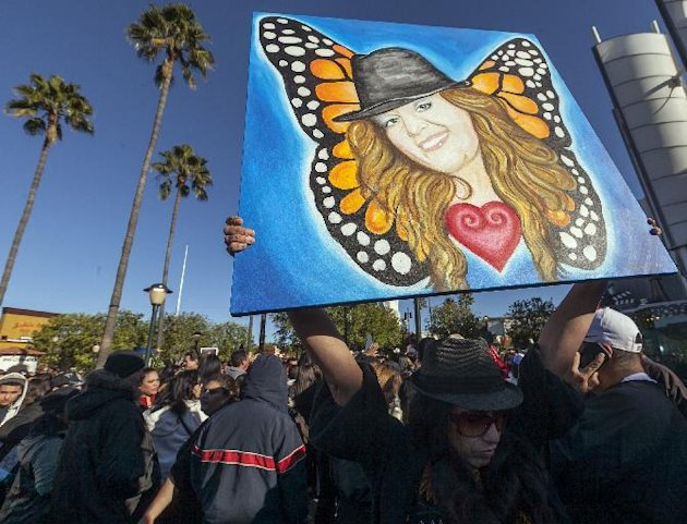 Fans mourn Jenni Rivera at a memorial televised a on giant television in Universal City in Los Angeles Wednesday, Dec. 19, 2012. The 43-year-old Rivera and six others died Dec. 9 in a crash that remai