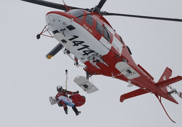 Austria's Kroell is rescued by a helicopter following his crash in the season's last men's Super-G race at the Alpine Skiing World Cup finals in Lenzerheide