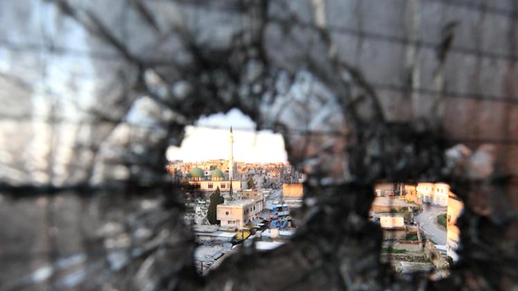 FILE - Bullet holes are seen in a window in Tripoli, Lebanon, Saturday, Feb. 11, 2012. Clashes between pro- and anti-Syria gunmen in the northern Lebanese city of Tripoli left two people dead and 12 wounded in the latest skirmish between Lebanese factions over the crisis in neighboring Syria. (AP Photo/Bilal Hussein, File)