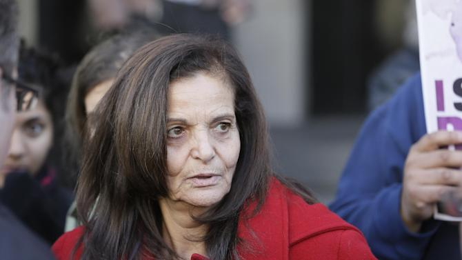 FILE- In this Monday, Nov. 10, 2014, file photo, Rasmieh Yousef Odeh, 67, of Chicago is interviewed outside federal court in Detroit, after the Palestinian immigrant was found guilty of immigration fraud for failing to disclose her conviction and imprisonment in a Jerusalem supermarket bombing that killed two people. Odeh was charged for not revealing an Israeli military court conviction for several bombings in 1969. She served 10 years before being released in a prisoner swap with the Popular Front for the Liberation of Palestine. On Wednesday, Nov. 19, 2014, federal prosecutors in Detroit asked a judge not to release her from jail while she awaits sentencing in March 2015, saying she has a history of deceit. (AP Photo/Carlos Osorio, File)