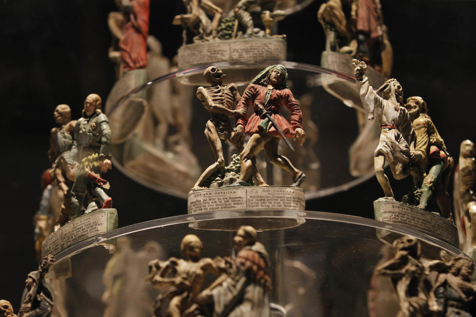 Some of the figures of 'The Zizenhausenner Dance of Death' by German artist Anton Sohn are seen on display at an exhibition 'Death: The Richard Harris Collection' at the Wellcome Collection gallery in London, Wednesday, Nov. 14, 2012. (AP Photo/Sang Tan)