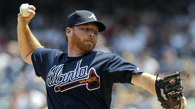 FILE - In this June 20, 2012, file photo, Atlanta Braves starting pitcher Tommy Hanson delivers in the second inning of a baseball game against the New York Yankees at Yankee Stadium in New York. The Braves traded Hanson to the Los Angeles Angels for former closer Jordan Walden on Friday, Nov. 30, 2012. (AP Photo/Kathy Willens, File)