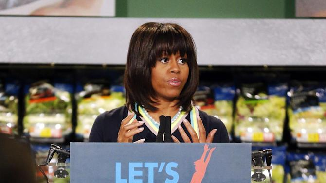 """First lady Michelle Obama at a Walmart Neighborhood Market in Springfield, Mo., Thursday, Feb. 28, 2013. Obama was promoting her campaign against childhood obesity and highlight """"the groundbreaking steps"""" the retailer has taken to make healthy food more affordable. (AP Photo/Orlin Wagner)"""
