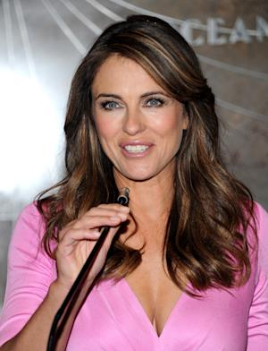 Spokesperson and model Elizabeth Hurley speaks before lighting the Empire State Building pink in honor of the 20th Anniversary of the Estee Lauder Companies' Breast Cancer Awareness Campaign on Monday, Oct. 1, 2012 in New York. (Photo by Evan Agostini/Invision/AP)