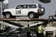 Syrian airport officials unload UN supplies from a plane at Damascus International Airport. China's foreign minister on Tuesday urged all parties in Syria to honour their ceasefire commitments, as the United Nations warned world powers were racing against time to stop war in the restive state