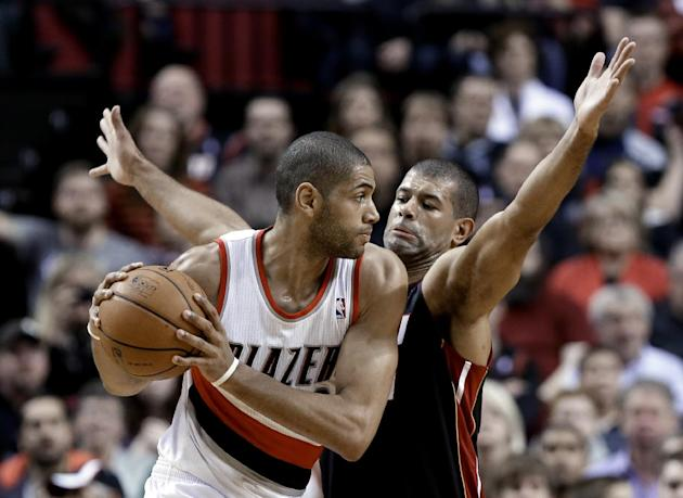 Miami Heat forward Shane Battier, right, plays tight defense against Portland Trail Blazers forward Nicolas Batum, from France, during the first half of an NBA basketball game in Portland, Ore., Satur