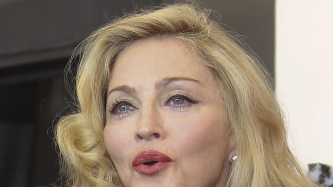 US singer and director Madonna blows a kiss at the photo call for the film W.E. during the 68th edition of the Venice Film Festival in Venice, Italy, Thursday, Sept. 1, 2011. (AP Photo/Joel Ryan)