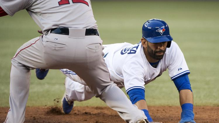 Toronto Blue Jays' Jose Bautista, right, tags back up at first base past Boston Red Sox first baseman Mike Napoli, left, during the fourth inning of a baseball game, Tuesday, July 22, 2014 in Toronto. (AP Photo/The Canadian Press, Nathan Denette)