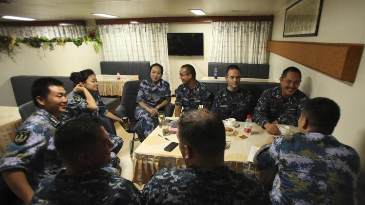 U.S. Navy medics from the U.S. Navy hospital Ship USN Mercy talk with medics from China's PLA while aboard PLA ship Peace Ark during the RIMPAC in Honolulu