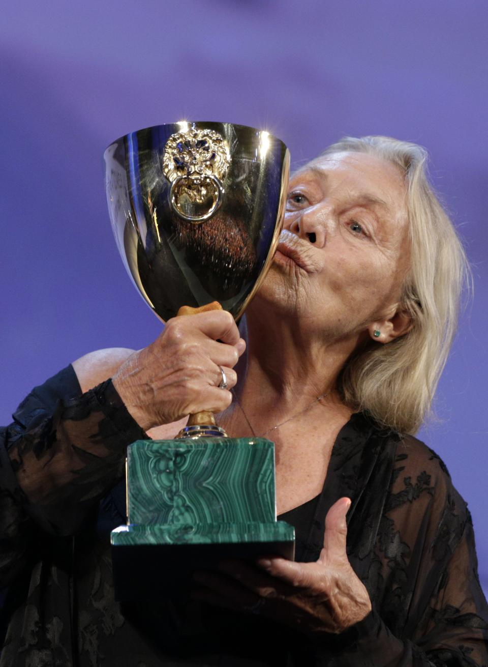 Actress Elena Cotta holds her Volpi Cup for Best Actress for her role in the film Via Castellana Bandiera, during the awards ceremony of the 70th edition of the Venice Film Festival in Venice, Italy, Saturday, Sept. 7, 2013. (AP Photo/Domenico Stinellis)