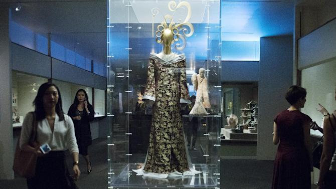 """Members of the media view selections for the Metropolitan Museum of Art Costume Institute Gala Benefit , """"China: Through the Looking Glass,"""" during a media preview at the Metropolitan Museum of Art in New York"""