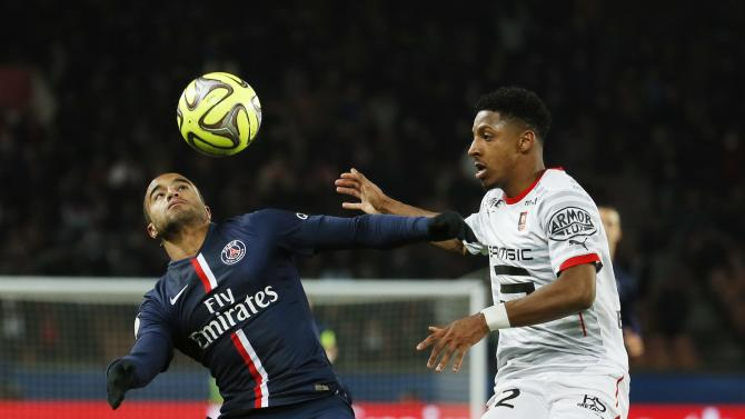 Paris St Germain's Lucas Moura is challenged by Stade Rennes' Steven Moreira during their French Ligue 1 soccer match at Parc des Princes stadium in Paris