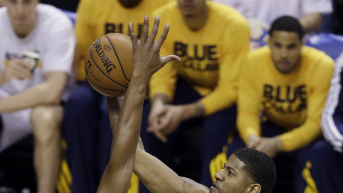 Indiana Pacers' Paul George puts up a shot against Miami Heat's Chris Bosh, left, during the first half of Game 3 of the NBA Eastern Conference basketball finals, Sunday, May 26, 2013, in Indianapolis. (AP Photo/Michael Conroy)