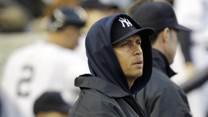 New York Yankees' Alex Rodriguez watches from the dugout during the fourth inning of Game 5 of the American League division baseball series against the Baltimore Orioles, Friday, Oct. 12, 2012, in New York. (AP Photo/Kathy Willens)