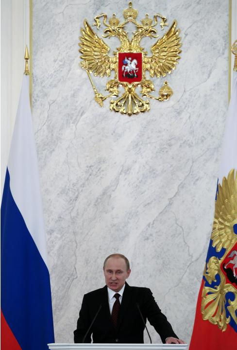 Russia's President Vladimir Putin speaks during his annual state of the nation address at the Kremlin in Moscow