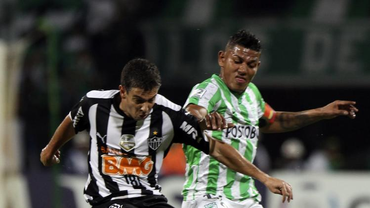 Leandro Donizete of Brazil's Atletico Mineiro fights for the ball with Alex Mejia of Colombia's Nacional during their Copa Libertadores soccer match in Medellin