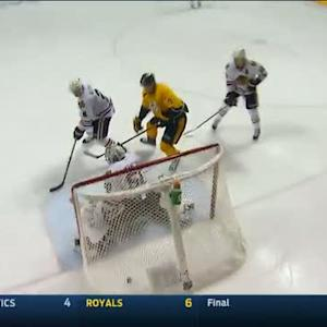 Forsberg tucks the puck under Crawford's pads