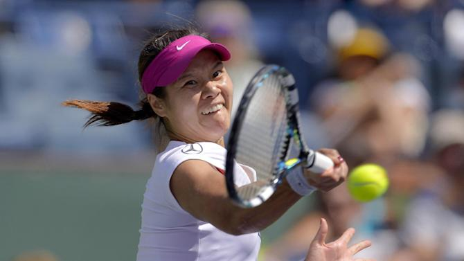 Li Na, of China, hits to Dominika Cibulkova, of Slovakia, during a quarterfinal match at the BNP Paribas Open tennis tournament, Thursday, March 13, 2014 in Indian Wells, Calif. (AP Photo/Mark J. Terrill)