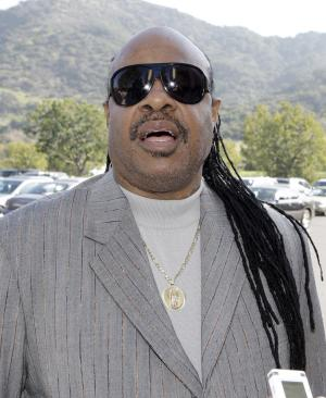 Stevie Wonder arrives at a memorial service for singer Teena Marie at Forest Lawn-Hollywood Hills in Los Angeles Monday. Jan. 10, 2011.  Teena Marie, whose given name was Mary Christine Brockert, died Dec. 26, 2010, at age 54. (AP Photo/Reed Saxon)