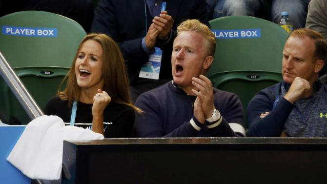 The entourage of Murray of Britain, including fiancee Kim Sears cheer him on during his men's singles final match against Novak Djokovic of Serbia at the Australian Open 2015 tennis tournament in Melbourne
