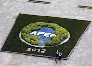 Two volunteers near the building of the media center for the APEC summit in Vladivostok on September 5. Japan and China are unlikely to hold summit talks on the sidelines of an upcoming Asia-Pacific meeting because of a row over disputed islands, a report said Thursday