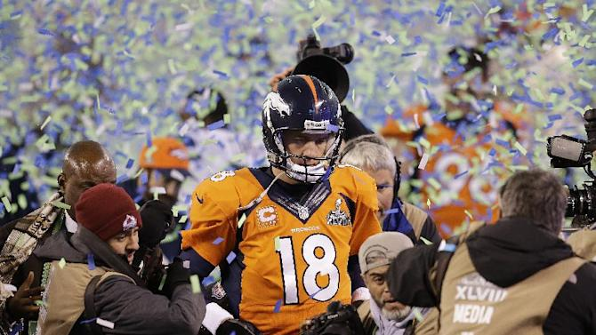 Denver Broncos quarterback Peyton Manning walks off the field after the Broncos lost to the Seattle Seahawks in the NFL Super Bowl XLVIII football game Sunday, Feb. 2, 2014, in East Rutherford, N.J. The Seahawks won 43-8. (AP Photo/Chris O'Meara)