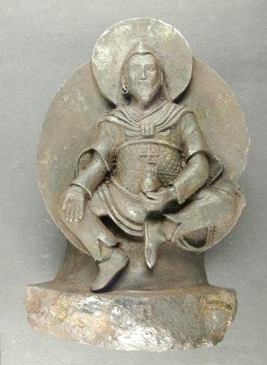 """The undated photo provided by University of Stuttgart shows an ancient Buddhist statue that a Nazi expedition brought back from Tibet shortly before World War II. The statue was carved from a meteorite which crashed on Earth thousands of years ago.  What sounds like an Indiana Jones movie plot appears to have actually taken place, according to European researchers publishing in the journal Meteoritics and Planetary Science this month. Elmar Buchner of the University of Stuttgart, said Thursday Sept 27 2012 that the statue was brought to Germany by the Schaefer expedition. The Nazi-backed venture set out for Tibet in 1938 in part to trace the origins of the Aryan race _ a cornerstone of the Nazis' racist ideology. The existence of the statue _ known as """"iron man"""" _ was only revealed  in 2007 when its owner died and it came up for auction, Buchner told The Associated Press. (AP Photo/University of Stuttgart, Elmar Buchner)"""