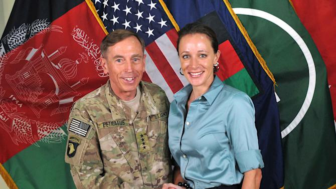 "FILE - This July 13, 2011, file photo, provided by the International Security Assistance Force's Flickr website shows the former Commander of International Security Assistance Force and U.S. Forces-Afghanistan Gen. Davis Petraeus, left, shaking hands with Paula Broadwell, co-author of his biography ""All In: The Education of General David Petraeus.""  A person close to Broadwell says she deeply regrets the damage that's been done from her affair with now-ex-CIA chief Petraeus, and she is trying to repair that and move forward. The friend spoke on condition of anonymity because he was not authorized to speak publicly. (AP Photo/ISAF, File)"