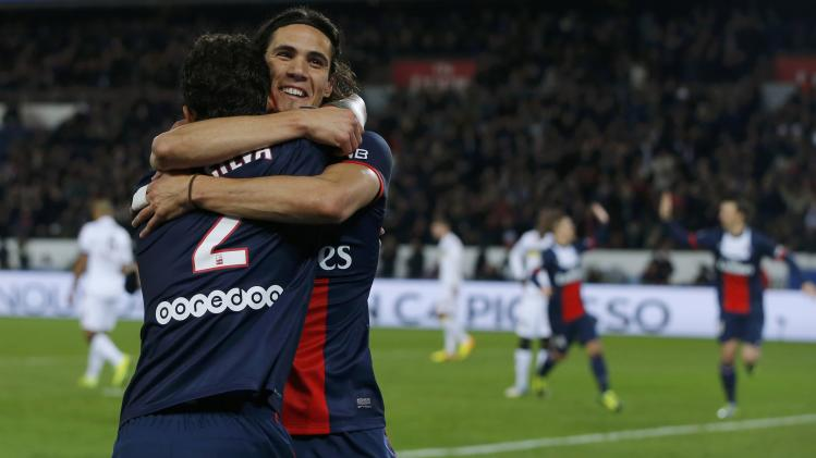Paris St Germain's Thiago Silva celebrates his goal with team mate Edinson Cavani after scoring against FC Sochaux during their French Ligue 1 soccer match at the Parc des Princes Stadium in Paris