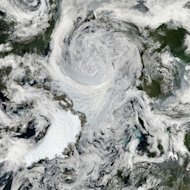 This mosaic of images taken by NASA's Aqua satellite shows an unusually strong storm over the Arctic Ocean on Aug. 6, 2012.