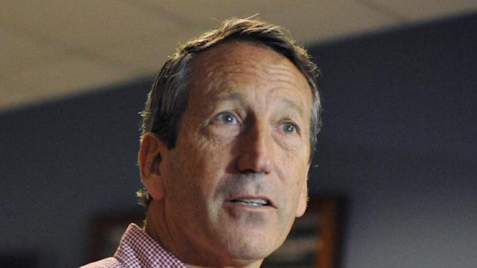Former South Carolina Gov. Mark Sanford speaks to the media after voting at a polling place in Charleston, S.C., Tuesday, May 7, 2013.   Sanford, a Republican, and Colbert Busch, a Democrat and sister of political satirist Stephen Colbert, are to face off for the 1st Congressional District seat, that was vacated when Tim Scott was appointed to the U.S. Senate. Green Party candidate Eugene Platt also is on the ballot. (AP Photo/Rainier Ehrhardt)