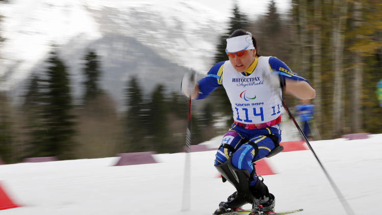 Lyudmyla Pavlenko of Ukraine races to win the ladies 12km cross country ski, sitting event at the 2014 Winter Paralympic, Sunday, March 9, 2014, in Krasnaya Polyana, Russia. (AP Photo/Dmitry Lovetsky)