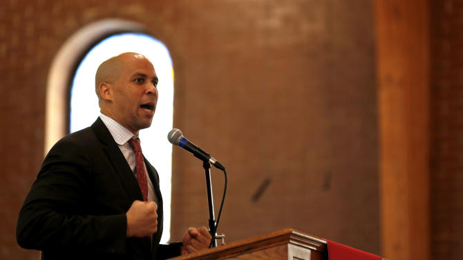 Newark Mayor Cory Booker talks to firefighter cadets during a swearing in ceremony into the Newark Fire Department, Tuesday, Oct. 9, 2012, in Newark, N.J. Twenty-eight of the 31 cadets served in the U.S. military fighting in Afghanistan or Iraq. The veterans were recruited through the GI Go Fund, a nonprofit New Jersey-based organization that helps provide assistance for veterans. The group worked with Mayor Booker to open a Veterans Center in Newark City Hall. (AP Photo/Julio Cortez)