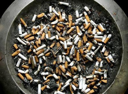 Cigarette butts lie in an ashtray outside a Montreal office building, February 21, 2005. [Quebec Sup..