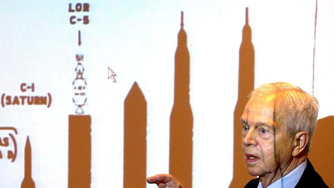 File-This Oct. 9, 2003, file photo shows John C. Houbolt explaining the size of different rockets required to launch various methods for landing on the moon at Grainger Engineering Library in Urbana, Ill. Houbolt, an engineer whose contributions to the U.S. space program were vital to NASA's successful moon landing in 1969, has died. He was 95. Houbolt's family confirmed his death Tuesday, April 15, 2014, at a Maine nursing home of complications from Parkinson's disease. (AP Photo/News-Gazette, John Dixon, File)