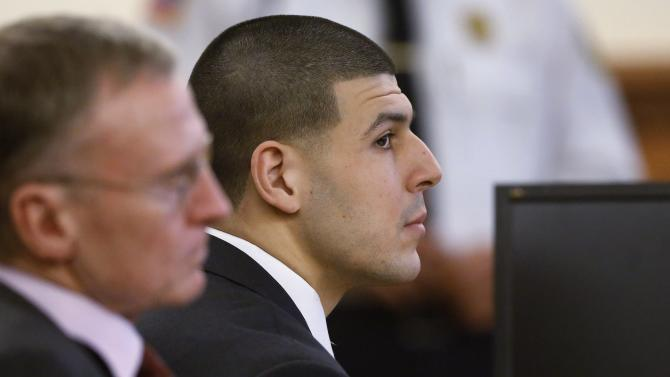 Former New England Patriots football player Aaron Hernandez listens during his trial as defense attorney Charles Rankin looks on in Fall River Massachusetts